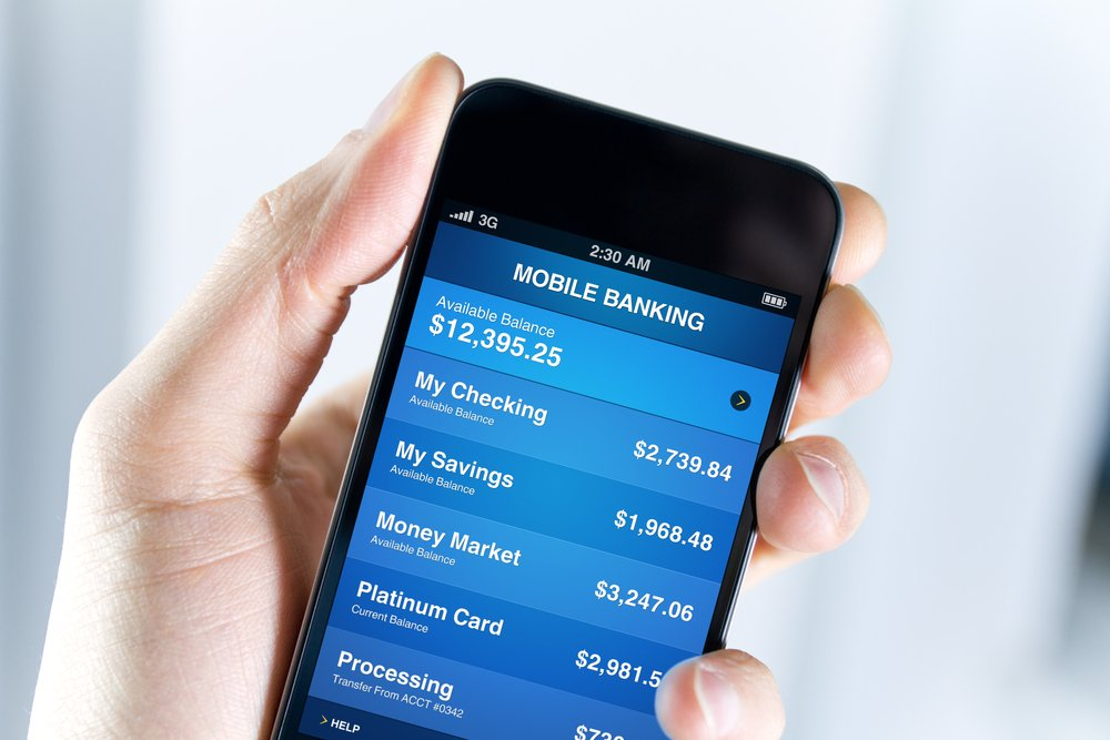 A,Man,Holding,Mobile,Smart,Phone,With,Mobile,Banking,Application