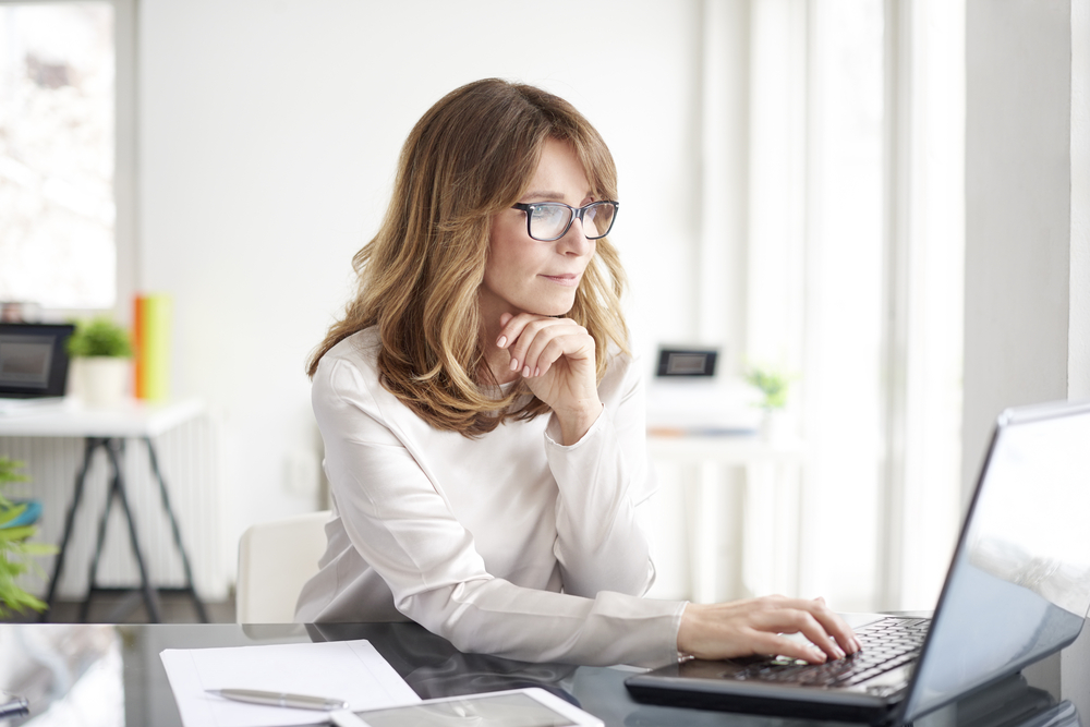 Shot,Of,An,Attractive,Mature,Businesswoman,Working,On,Laptop,In