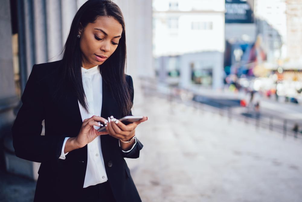 African,American,Female,Entrepreneur,In,Corporate,Suit,Using,Online,Banking